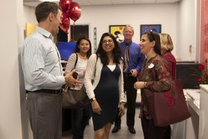 Some cast members mingling during the DU open house